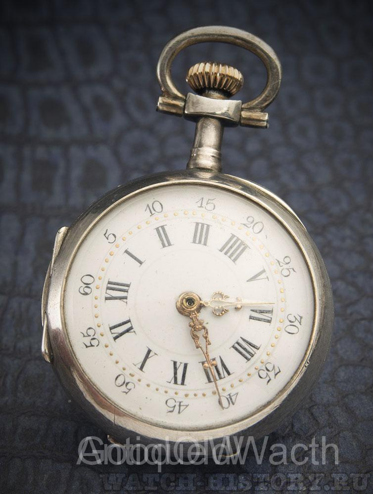 SIlver lady pocket watch with unusual time setting mechanism